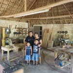 A Mayan family in the husband's workshop